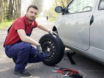 Man fixing a car problem stock images