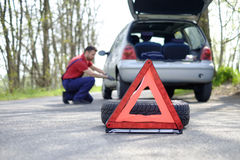 Man fixing a car problem after vehicle breakdown Stock Photos