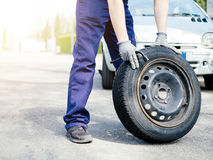 Man fixing a car problem after vehicle breakdown on the road Royalty Free Stock Photography