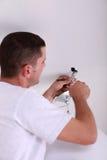 Man fixing ceiling light stock photos