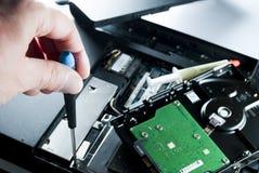 Man fixing computer Stock Image