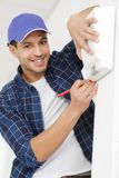 Man before fixing device. Man before fixing a device royalty free stock photography