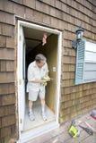 Man fixing door stock images