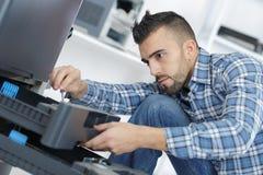 Man fixing electronic circuits. Man royalty free stock image
