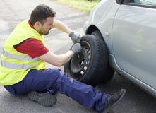 Man fixing flat tire Royalty Free Stock Photos