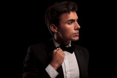 Free Man Fixing His Bow Tie And Looks To Side Stock Photo - 85593180