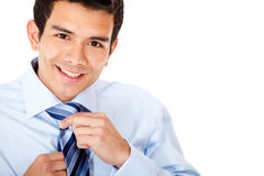 Man fixing his tie Royalty Free Stock Photo