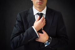Man fixing his tie Stock Image