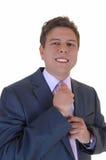 Man fixing his tie. Royalty Free Stock Image