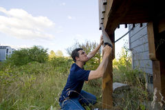 Man Fixing House - Horizontal Stock Images