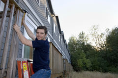 Man Fixing House - Horizontal Stock Images