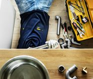 Man fixing and installing kitchen sink royalty free stock photos