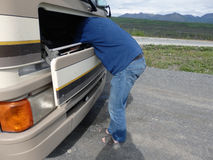 A man fixing a motor home Royalty Free Stock Photo