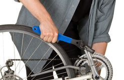 Man fixing pedals on a bicycle Stock Image