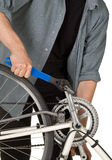 Man fixing pedals on a bicycle Royalty Free Stock Photography