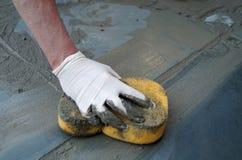 Man Fixing Sidewalk Royalty Free Stock Image