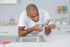 Man fixing sink connection Royalty Free Stock Image