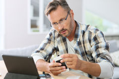 Man fixing smartphone with internet assistance Royalty Free Stock Photo