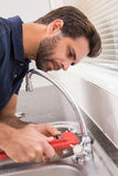 Man fixing tap with tool Royalty Free Stock Photo