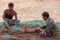 2 man are fixing there fishing boat nets. Chaktai Khal called grief of Chittagong City. It is a most important part of Chittagong sea port and Karnafuli River Stock Photo