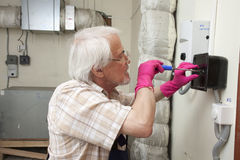 Man fixing ventilation stack Stock Photo
