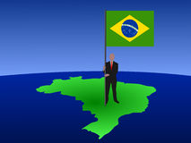 Man with flag of Brazil on map Stock Photos