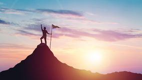Man with flag celebrates victory on top of a mountain at sunset royalty free stock photography