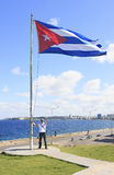 Man with a flag of Cuba. Man with a flag on the site of Hotel Nacional de Cuba Royalty Free Stock Image