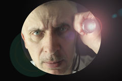 Man with a flashlight Stock Image