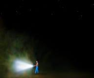 Man with flashlight Stock Photos