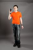 Man with flashmeter. Man in photo studio with flashmeter in the hand Royalty Free Stock Photo