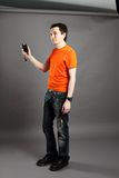 Man with flashmeter. Man in photo studio with flashmeter in the hand Stock Photo