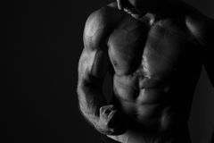 Man Flexing Biceps Sport Background Royalty Free Stock Image