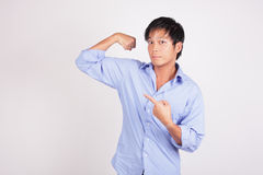 Man flexing his arm Royalty Free Stock Photo