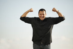 Man flexing his arms royalty free stock image