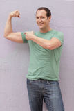 Man flexing his muscles Stock Photo
