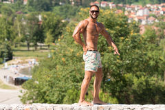 Man Flexing Muscles Outdoors In Summer Time Royalty Free Stock Images