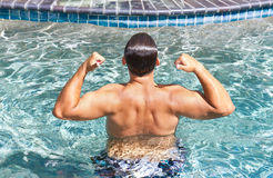 Man Flexing Pool Stock Photo