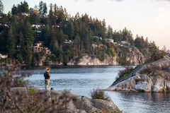 A man flies his drone over the ocean at Whytecliff Park., West Vancouver. royalty free stock photo