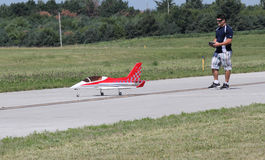 Man flies Model Airplane with controller Stock Images