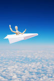 Man flies over clouds in the toy paper plane Royalty Free Stock Photos