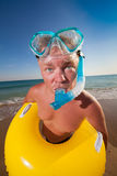 Man in flippers and mask. On the bank of the sea Royalty Free Stock Photo