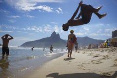 Man Flipping Rio de Janeiro Beach Brazil Stock Photo