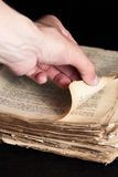 Man flips through an old copy of the Bible Royalty Free Stock Photography