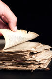 Man flips through an old copy of the Bible. Man leafing through a thick old book Stock Photography
