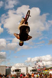 Man Flips Upside Down Performing BMX Stunt At Fair Royalty Free Stock Photography