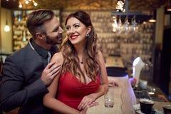 Man flirt to beautiful woman. Man flirt to beautiful women inside at evening stock photography