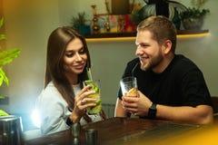 Man flirting with beautiful woman in the bar stock photos