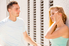 Man flirting with girl on city street Stock Images