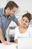 Man flirting with his colleague in office. Man flirting with his colleague in the office Royalty Free Stock Photography